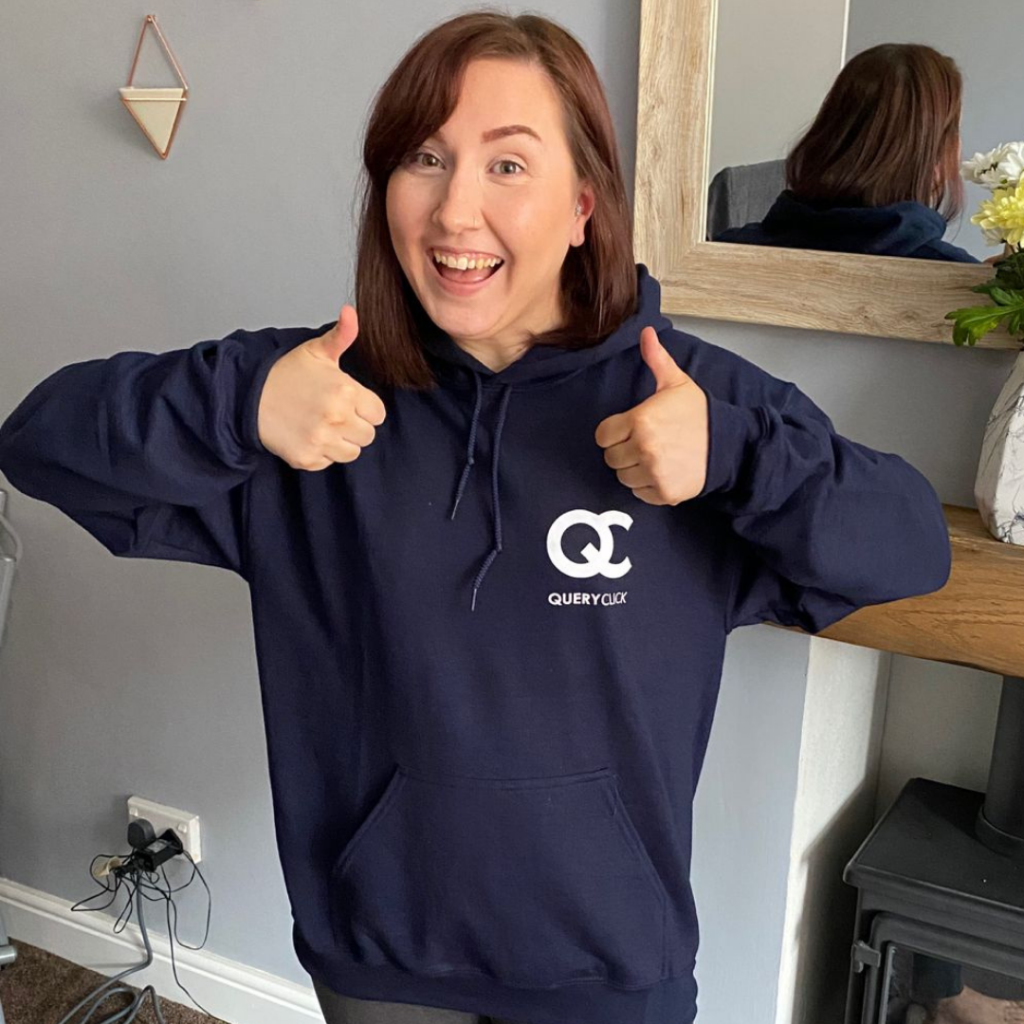 New QC employee, Laura, showing off her QC hoodie.